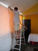 Glen and Christine hanging white walls